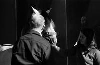 James A. Michener and a woman interacting with a horse.