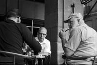 James A. Michener and Kenneth Vanderford sitting in an outdoor café