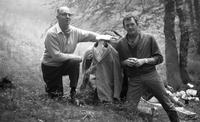 James A. Michener and John Fulton pose in the forest