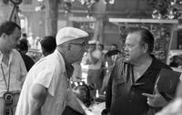 James A. Michener conversing with Orson Welles