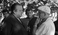 James A. Michener conversing with Orson Welles and John Fulton