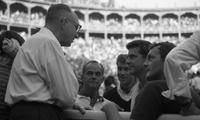 James A. Michener conversing in a bullring