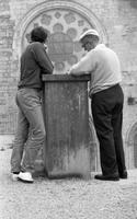 James A. Michener and John Fulton leaning against a stone newel