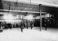 Women playing softball in Cranford Hall gymnasium, State Normal School