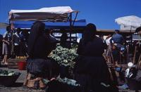 Unidentified women at an outdoor market, ca. 1960s