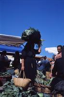 Unidentified woman at an outdoor market, ca. 1960s