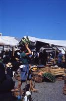 Unidentified womqn at an outdoor market, ca. 1960s