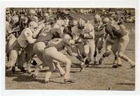 Action shot of the Colorado State College football during game against Adams State College, 1968.