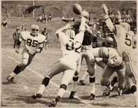 Action shot of the defensive unit of the Colorado State College football team, 1969.