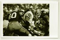 Action shot of Adam Popielarchek, football player, University of Northern Colorado, 1993.