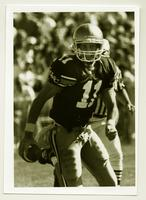 Action shot of the University of Northern Colorado football team's quarterback, 1993.