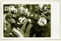 Action shot of a University of Northern Colorado football player, 1993.