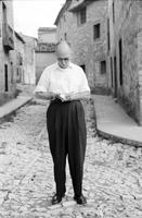 James A. Michener taking notes on a stone road