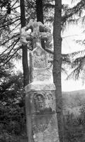 Stone sculpture with cross