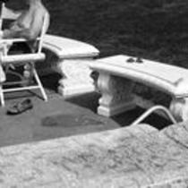 James A. Michener sitting outside, with a towel in his lap