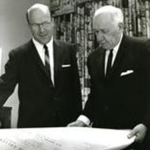 President Darrell Holmes and Dr. William Ross looking at the plans for the Science Building, eventually named Ross Hall.