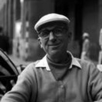 James A. Michener sitting at an outdoor café