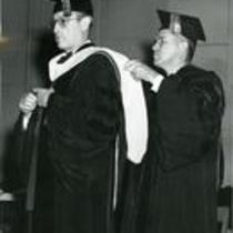 President George Frasier and unidentified man in academic regalia