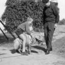 James A. Michener with a hyena and young boy