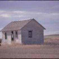 James Michener and Tessa Dalton at deserted homestead near Keota, CO
