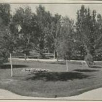 Grassy lawn with circular flower bed, State Normal School campus