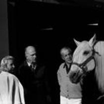 James A. Michener with an unidentified couple and a horse.