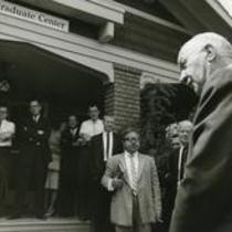 President William Ross addressing a group in front of the Graduate Center