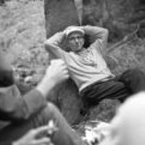 James A. Michener conversing with friends in a forest