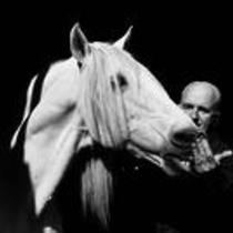 James A. Michener interacting with a horse.
