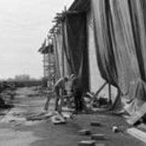 Two men work at University Library construction site, early 1970s