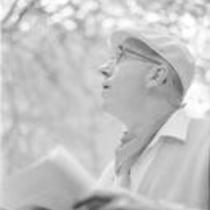 James A. Michener sitting among trees