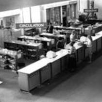 Circulation department as seen from the staircase in Michener Library, ca. 1980s