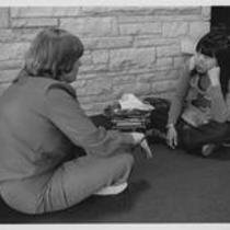 Students in the interior of the University Center, ca. 1970s?