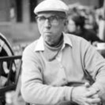 James A. Michener sitting at an outdoor café