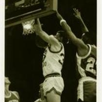 Action shot, University of Northern Colorado vs. Mesa State College men's basketball, ca. 1990s.