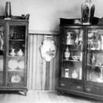 Corner grouping of displayed pottery objects, State Normal School