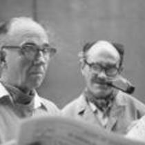 James A. Michener and Angus Macnab reading a newspaper