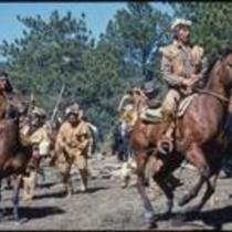 """""""Mountain man"""" actor pulls ahead in horse race scene in Centennial, Estes Park, Colorado, 1978"""