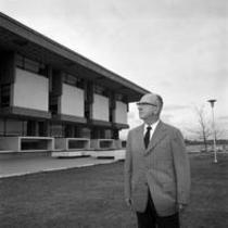 James A. Michener in front of Michener library, looking eastward, ca. 1972