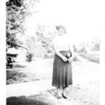 Young Woman in Front Lawn