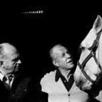 James A. Michener with an unidentified man and a horse.