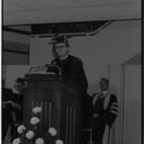Richard R. Bond speaking at podium during Michener Library dedication, 1972