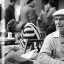 James A. Michener sitting at an outdoor café with an unidentified gentleman