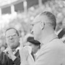 James A. Michener in a stadium, interacting with an unidentified gentleman