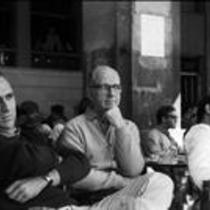 James A. Michener sitting in a courtyard with three unidentified men