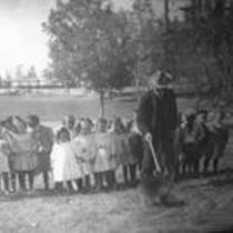 Children, man, and porcupine, State Normal School campus