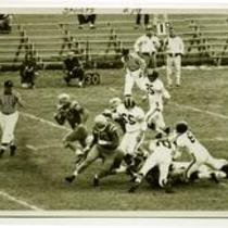 Action shot of unidentified Colorado State College football players, 1959.