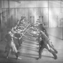 Men  practicing fencing in the Cranford gymnasium, State Normal School