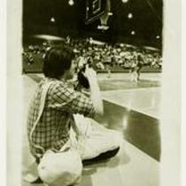 Photographer at University of Northern Colorado basketball game, 1982.