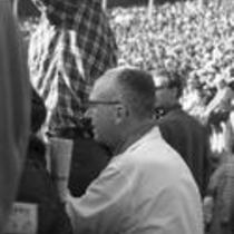 James A. Michener peeking through the audience